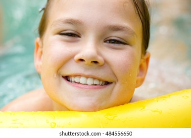 Close-up portrait of a girl in swimming pool, outdoor shoot