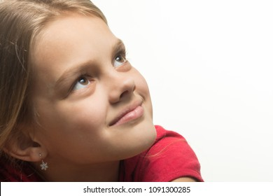 Close-up portrait of a girl who looked up