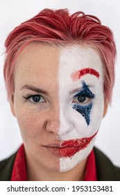 Close-up (portrait) of the girl's face, exactly half of which is painted with the makeup of a clown or mime. Two-faced. The juxtaposition of emotions of joy and sadness. Yin and yang.
