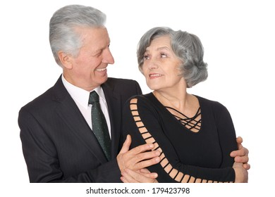 Close-up portrait of a glad elder couple on white background