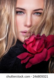 Closeup portrait of gorgeous stylish woman with beautiful blond hair and fresh red rose, fashion lifestyle, beauty and vogue concept