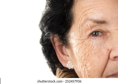 closeup portrait of grandmother looking nostalgic at camera