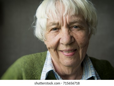 Close-up portrait of a gray-haired smiling old woman