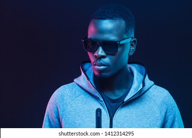 Close-up portrait of handsome black man, wearing hoodie and sunglasses