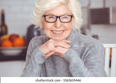 Closeup portrait of handsome blonde adult businesswoman toothy smile