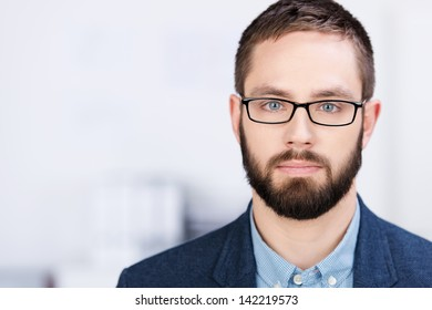 Closeup portrait of handsome businessman in office