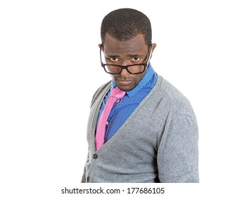 Closeup portrait of handsome cocky guy with big black glasses looking at you camera gesture skeptically, isolated on white background. Negative human emotion facial expression feeling, body language