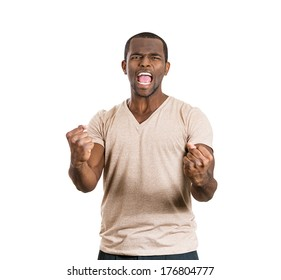 Closeup portrait of handsome happy, screaming young student man winning, arms fists pumped celebrating success, isolated on white background, Positive human emotion, facial expression feeling reaction