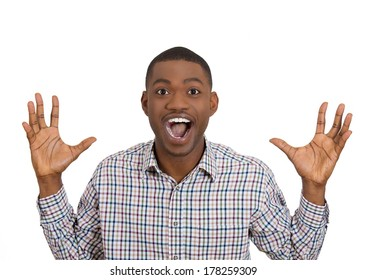 Closeup portrait of handsome happy, screaming young student man winning, arms fists pumped, up in air celebrating success isolated on white background, positive human emotion facial expression feeling
