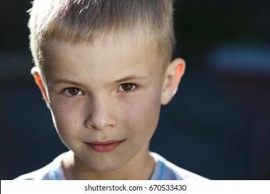 Close-up portrait of a handsome little boy
