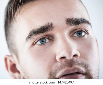 A closeup portrait of a handsome man with beautiful eyes