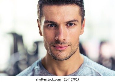 Closeup portrait of a handsome man at gym