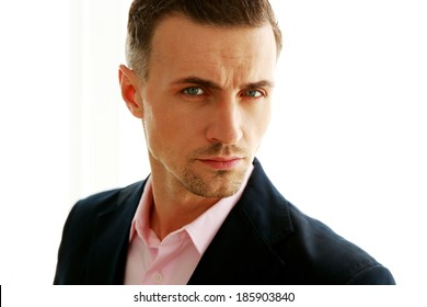 Closeup portrait of a handsome man isolated on a white background
