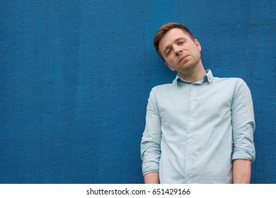 Closeup portrait of a handsome man on blue background