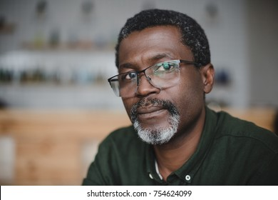close-up portrait of handsome mature african american man in bar