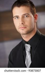 Closeup portrait of handsome young businessman.?