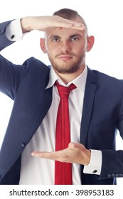 close-up portrait of a handsome young man in a suit gestures on a white background studio