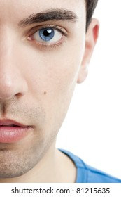 Close-up portrait of handsome young man with blue eyes