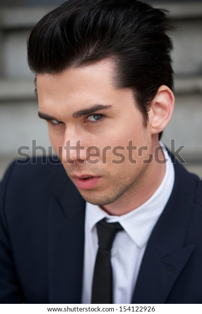Closeup portrait of a handsome young man in suit and tie