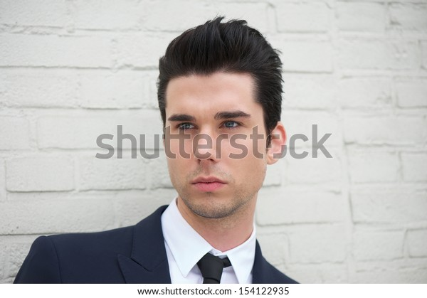 Closeup portrait of a handsome young man in business suit