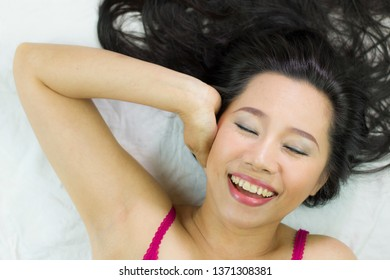 Closeup portrait of happy asian women  lying on ground with black long hair.