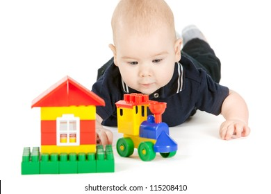 closeup portrait of happy baby playing with bright constructor over white background