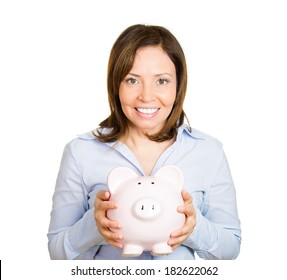 Closeup portrait of happy beautiful business woman, bank employee, showing, holding piggy bank, isolated white background. Financial savings concept. Positive human emotions, facial expression
