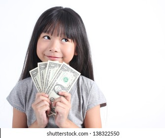 Closeup portrait of happy beautiful little asian girl holding money isolated on white background. Asian girl counting salary dollar note. Success financial business currency bill payment concept.