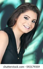 Closeup portrait of a happy, beautiful teen brunette.