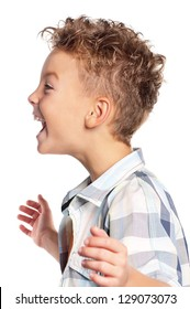 Close-up of portrait happy boy shouting on white background