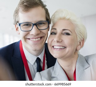 Close-up of portrait of happy business people in convention center