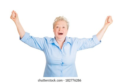 Closeup portrait of happy, cute, senior mature woman shocked, surprised, in full disbelief hands in air, isolated white background. Positive human emotion, facial expression, feeling, reaction
