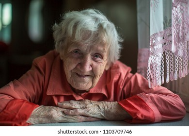 Closeup portrait of happy elderly woman.