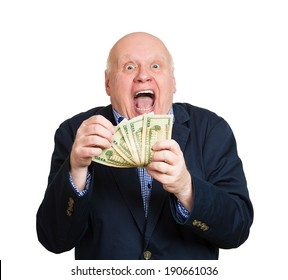 Closeup portrait, happy, excited successful senior lucky elderly man holding money dollar bills in hand isolated white background. Positive emotion facial expression feeling. Financial reward savings
