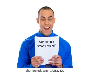 Closeup portrait of happy excited young man looking at monthly statement glad to pay off bills, isolated on white background. Positive emotion facial expression feelings. Financial success, good news