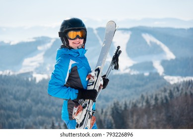 Close-up portrait of happy female skier smiling to the camera wearing skiing gear copyspace happiness positivity vacation travelling resort