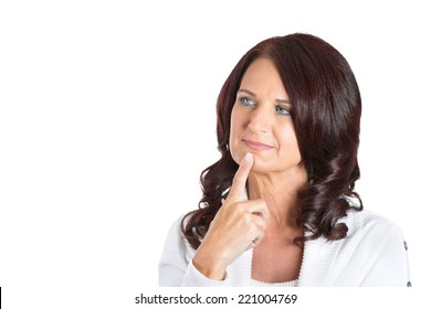 Closeup portrait happy middle aged woman with finger on chin daydreaming deeply about something, isolated white background. Positive emotion facial expression feelings, attitude, reaction, situation