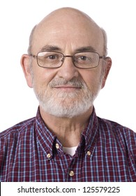 Close-up portrait of a happy old man wearing eyeglasses on a white background
