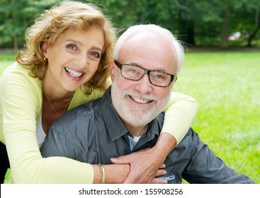 Closeup portrait of a happy older couple smiling  and showing affection