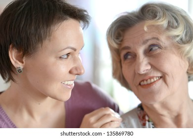 close-up portrait of a happy older woman and a young woman