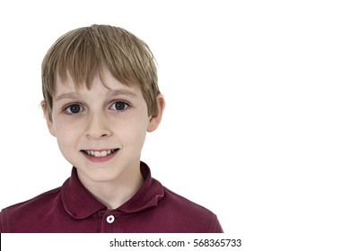 Close-up portrait of a happy pre-teen boy over white background
