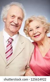 Close-up portrait of a happy senior couple smiling at the camera
