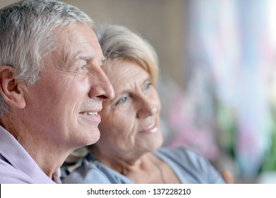close-up portrait of a happy senior couple at home