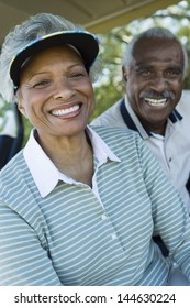 Closeup portrait of happy senior couple in golf course smiling