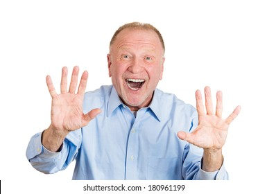 Closeup portrait of happy, senior mature man looking shocked surprised, hands in air to say stop, open mouth eyes, isolated on white background. Positive human emotion facial expression feeling