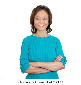 Closeup portrait of happy smiling amiable mirthful successful pretty senior mature woman in aqua sweater with arms crossed, isolated on white background. Positive emotion facial expression feelings.