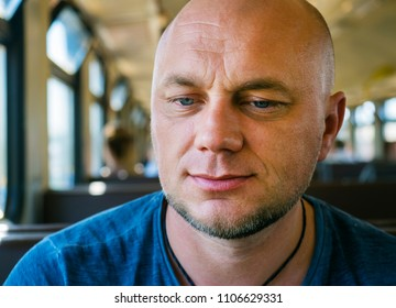 Close-up portrait of a happy smiling bald man