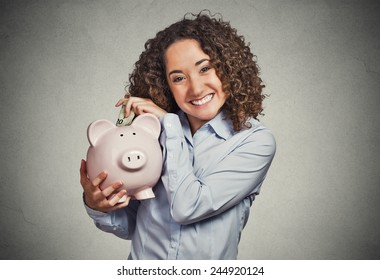 Closeup portrait happy smiling business woman bank employee, student holding piggy bank, excited to open savings account isolated grey background. Financial concept. Positive emotion facial expression