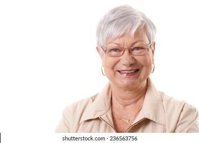 Closeup portrait of happy smiling elderly lady, looking at camera.