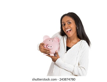 Closeup portrait happy, smiling middle aged business woman, bank employee holding piggy bank, isolated white background. Financial savings, banking concept. Positive emotions, face expressions